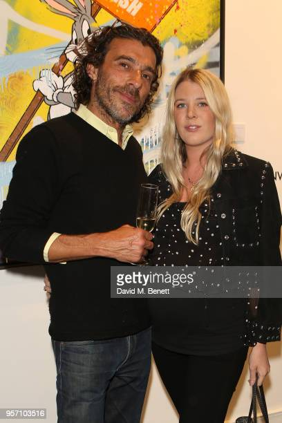 Derrick Santini and Gracie Egan attend Once Upon A Time by contemporary Irish street artist Robyn Ward on May 10 2018 in London England