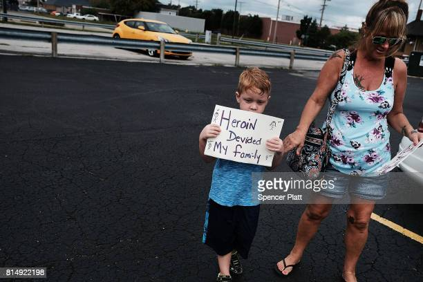 Derrick Slaughter attends a march through the streets of Norwalk against the epidemic of heroin with his grandmother on July 14 2017 in Norwalk Ohio...