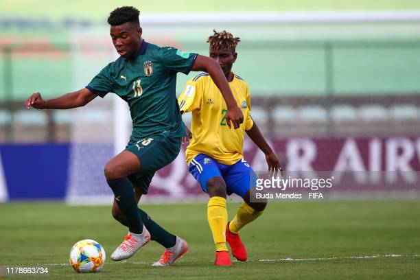 Derrick Taebo of Solomon Islands struggles for the ball with Iyenoma Udogie of Italy during the FIFA U17 Men's World Cup Brazil 2019 group F match...