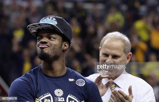 Derrick Walton Jr #10 of the Michigan Wolverines and head coach John Beilein celebrate following their 7156 win over the Wisconsin Badgers to win the...