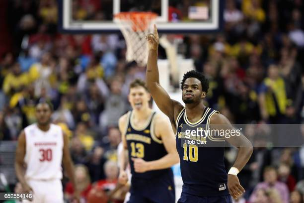 Derrick Walton Jr #10 of the Michigan Wolverines celebrates after hitting a three pointer against the Wisconsin Badgers in the first half during the...
