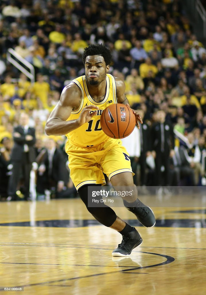 Derrick Walton Jr. #10 of the Michigan Wolverines drives to the basket against the Michigan State Spartans in the in the second half at Crisler Arena on February 7, 2017 in Ann Arbor, Michigan.