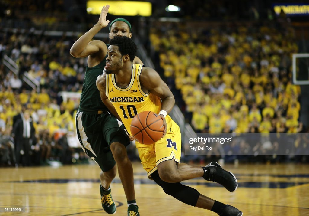 Derrick Walton Jr. #10 of the Michigan Wolverines drives to the basket against Cassius Winston #5 of the Michigan State Spartans in the in the second half at Crisler Arena on February 7, 2017 in Ann Arbor, Michigan.