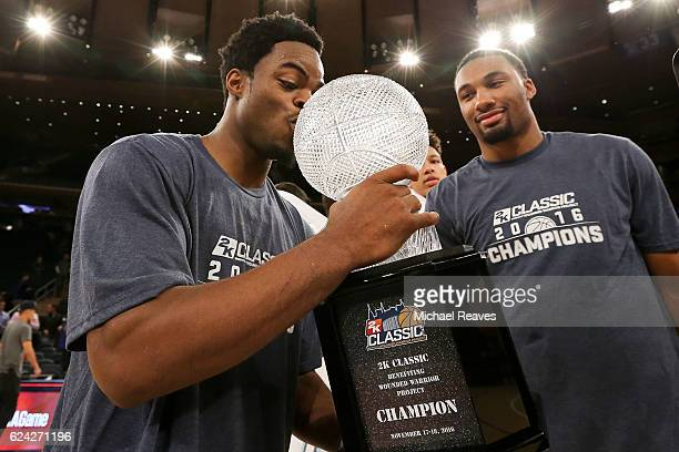 Derrick Walton Jr #10 of the Michigan Wolverines kisses the trophy after they defeated the Southern Methodist Mustangs 7654 in the 2K Classic...