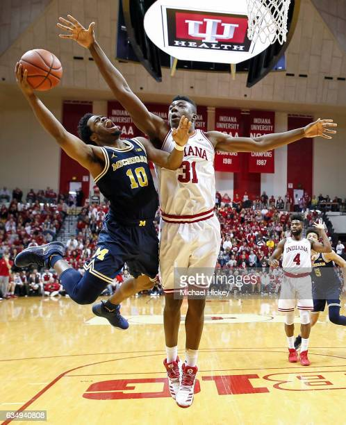 Derrick Walton Jr #10 of the Michigan Wolverines shoots the ball against Thomas Bryant of the Indiana Hoosiers at Assembly Hall on February 12 2017...