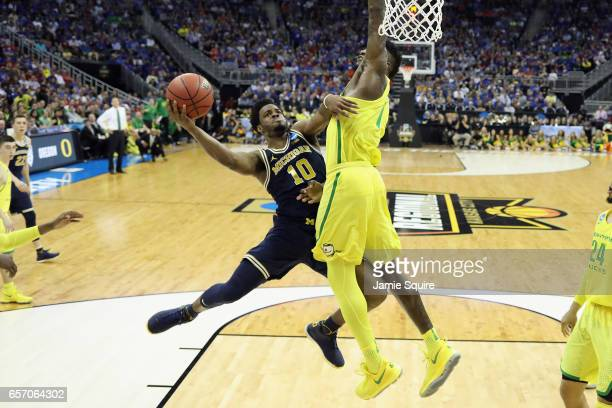 Derrick Walton Jr #10 of the Michigan Wolverines shoots the ball against Jordan Bell of the Oregon Ducks in the second half during the 2017 NCAA...