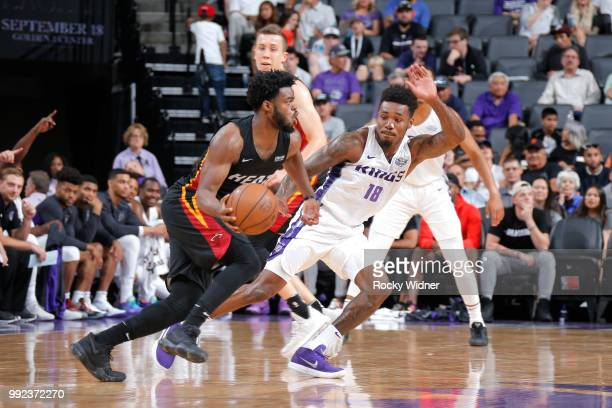 Derrick Walton Jr # 14 of the Miami Heat handles the ball against Daxter Miles Jr #18 of the Sacramento Kings during the 2018 Summer League at the...