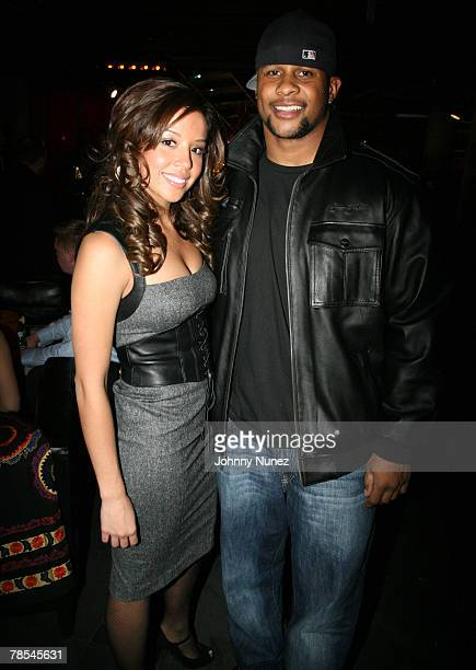 Derrick Ward and Guest attend Michael Strahan's Santa's BIG Helper Christmas Party at Club Slate December 17 2007 in New York City