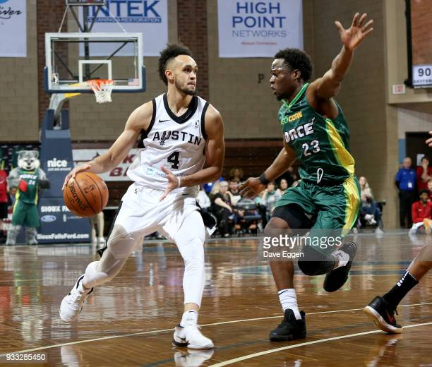 Derrick White from the Austin Spurs drives against Bubu Palo from the Sioux Falls Skyforce during an NBA GLeague game on March 17 2018 at the Sanford...