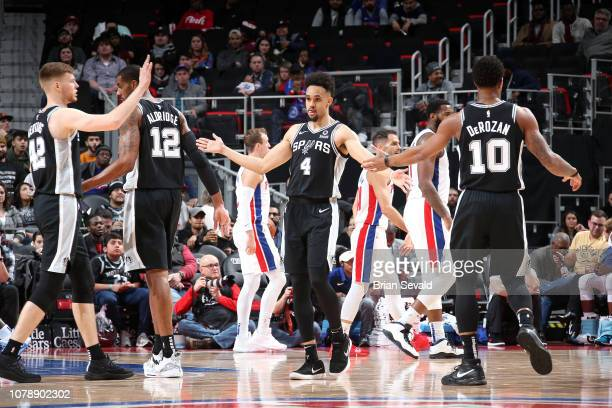 Derrick White hifives Davis Bertans and DeMar DeRozan of the San Antonio Spurs on January 7 2019 at Little Caesars Arena in Detroit Michigan NOTE TO...