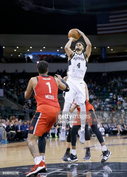 Derrick White of the Austin Spurs shoots the ball against Kennedy Meeks of the Raptors 905 during the NBA GLeague Playoffs Game 1 on April 8 2018 at...
