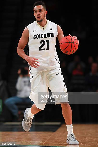 Derrick White of the Colorado Buffaloes dribbles up court against the Texas Longhorns in the second half during the consolation game of the Legends...