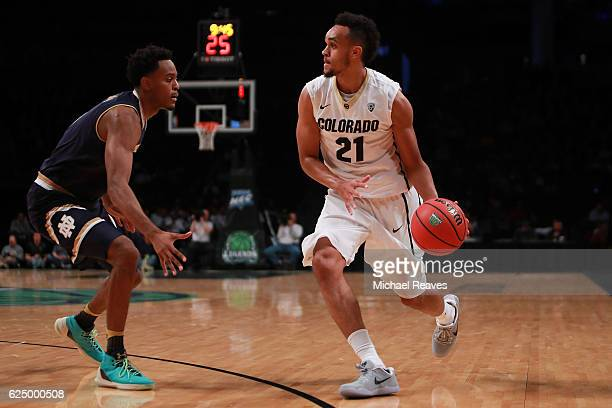 Derrick White of the Colorado Buffaloes drives to the basket on VJ Beachem of the Notre Dame Fighting Irish in the first half of the 2016 Legends...