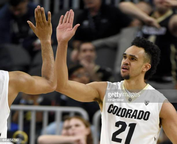 Derrick White of the Colorado Buffaloes gets a highfive from a teammate after he scored against the Washington State Cougars during a firstround game...