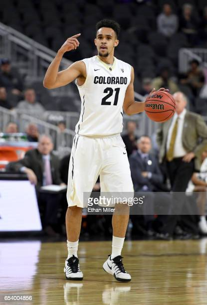 Derrick White of the Colorado Buffaloes sets up a play against the Washington State Cougars during a firstround game of the Pac12 Basketball...