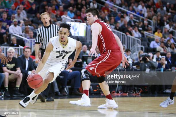 Derrick White of the Colorado Buffalos handles the ball against Conor Clifford of the Washington State Cougars during a firstround game of the Pac12...