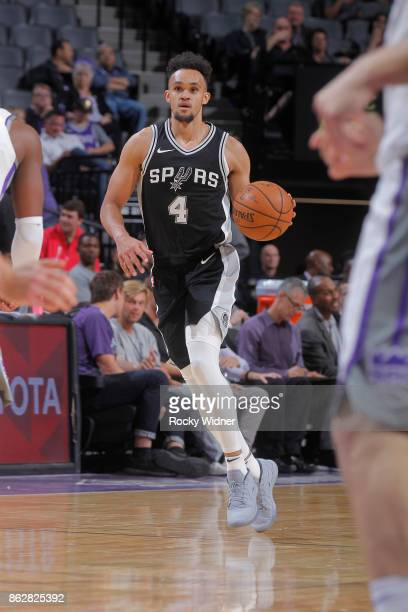 Derrick White of the San Antonio Spurs brings the ball up the court against the Sacramento Kings on October 2 2017 at Golden 1 Center in Sacramento...