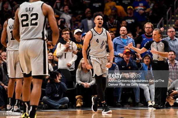 Derrick White of the San Antonio Spurs celebrates throwing a dunk down on Paul Millsap of the Denver Nuggets during the third quarter of the Spurs'...