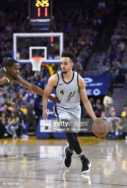 Derrick White of the San Antonio Spurs dribbles the ball up court while closely guarded by Kevin Durant of the Golden State Warriors during an NBA...