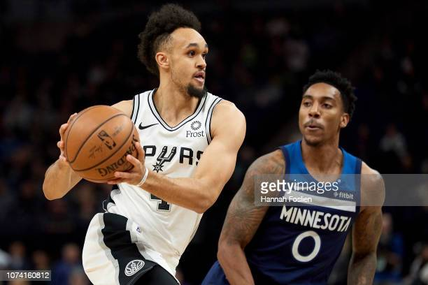 Derrick White of the San Antonio Spurs drives to the basket against Jeff Teague of the Minnesota Timberwolves during the game on November 28 2018 at...