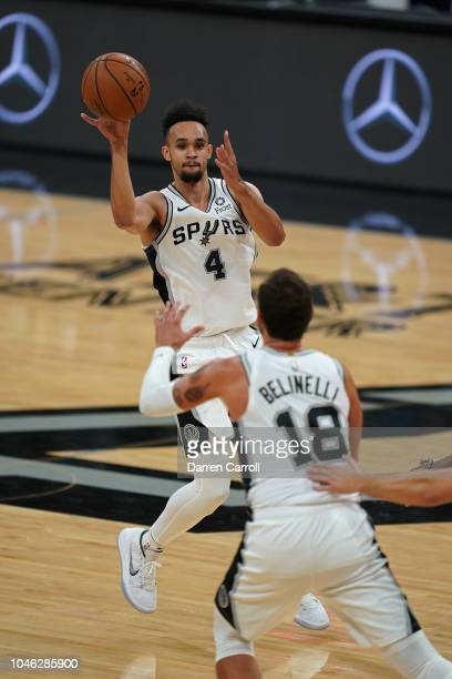 Derrick White of the San Antonio Spurs drives to the basket and passes the ball against the Detroit Pistons during a preseason game at ATT Center in...