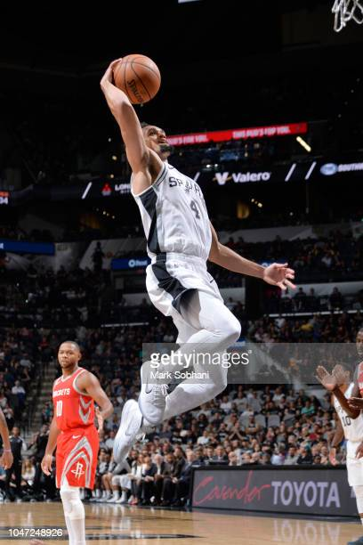 Derrick White of the San Antonio Spurs dunks the ball against the Houston Rockets during a preseason game on October 7 2018 at the ATT Center in San...