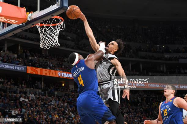 Derrick White of the San Antonio Spurs dunks the ball against the Denver Nuggets during Game One of Round One of the 2019 NBA Playoffs on April 13...