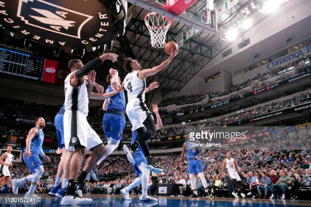Derrick White of the San Antonio Spurs goes to the basket against the Dallas Mavericks on March 12 2019 at the American Airlines Center in Dallas...