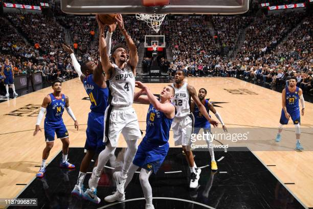 Derrick White of the San Antonio Spurs goes to the basket against the Denver Nuggets during Game Three of Round One of the 2019 NBA Playoffs on April...