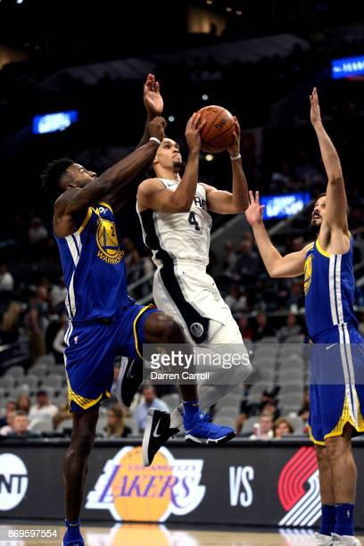 Derrick White of the San Antonio Spurs goes to the basket against the Golden State Warriors on November 2 2017 at the ATT Center in San Antonio Texas...