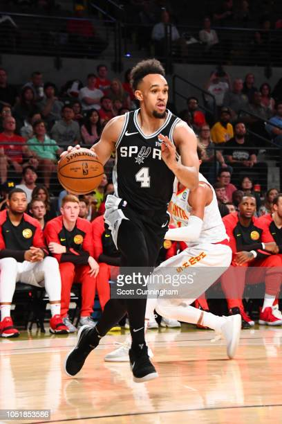 Derrick White of the San Antonio Spurs handles the ball against the Atlanta Hawks during a preseason game on October 10 2018 at McCamish Pavilion in...
