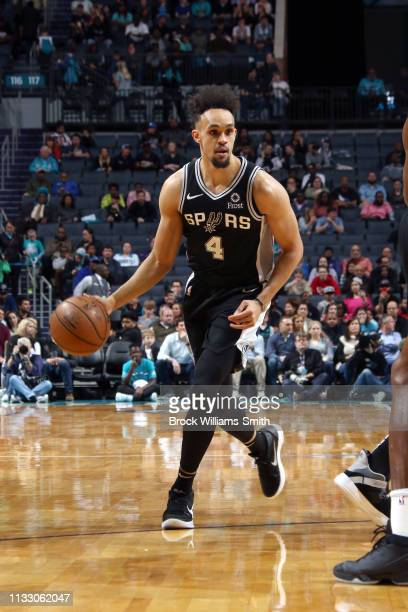 Derrick White of the San Antonio Spurs handles the ball against the Charlotte Hornets on March 26 2019 at the Spectrum Center in Charlotte North...
