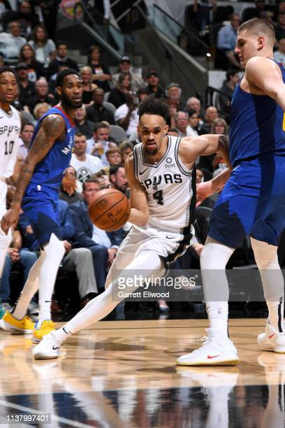 Derrick White of the San Antonio Spurs handles the ball against the Denver Nuggets during Game Three of Round One of the 2019 NBA Playoffs on April...