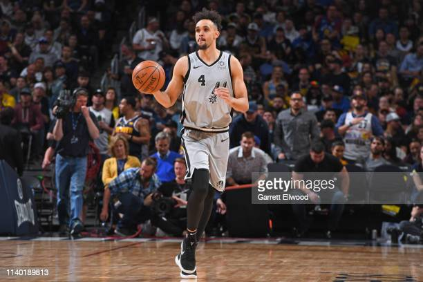 Derrick White of the San Antonio Spurs handles the ball against the Denver Nuggets during Game Seven of Round One of the 2019 NBA Playoffs on April...