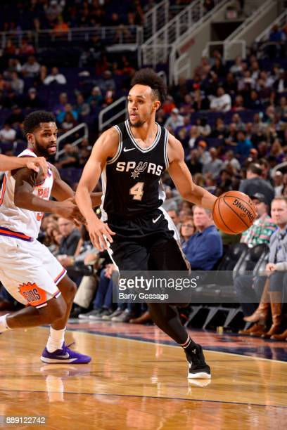 Derrick White of the San Antonio Spurs handles the ball against the Phoenix Suns on December 9 2017 at Talking Stick Resort Arena in Phoenix Arizona...