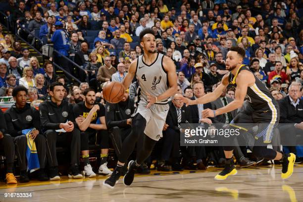 Derrick White of the San Antonio Spurs handles the ball against the Golden State Warriors on February 10 2018 at ORACLE Arena in Oakland California...