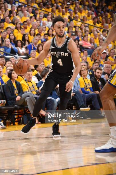 Derrick White of the San Antonio Spurs handles the ball against the Golden State Warriors in Game One of Round One during the 2018 NBA Playoffs on...