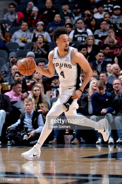 Derrick White of the San Antonio Spurs handles the ball during the game against the Denver Nuggets on March 4 2019 at the ATT Center in San Antonio...