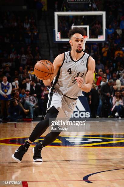 Derrick White of the San Antonio Spurs handles the ball during the game against the Denver Nuggets on April 3 2019 at the Pepsi Center in Denver...