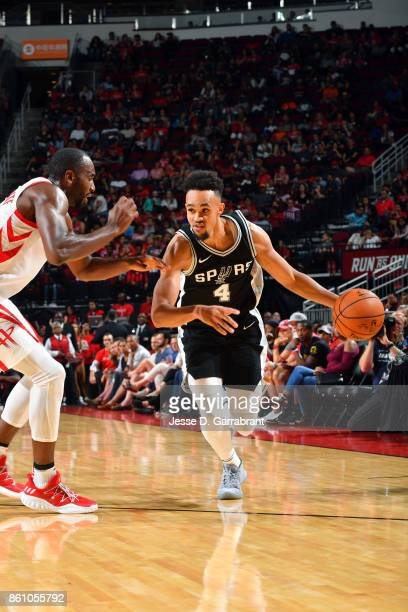 Derrick White of the San Antonio Spurs handles the ball during the preseason game against the Houston Rockets on October 13 2017 at Toyota Center in...