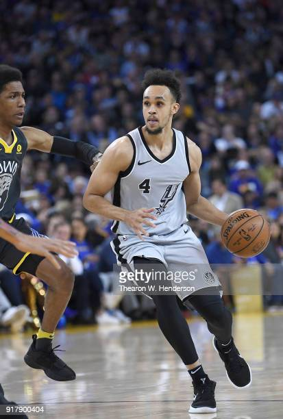 Derrick White of the San Antonio Spurs looks to drive on Patrick McCaw of the Golden State Warriors during an NBA basketball game at ORACLE Arena on...