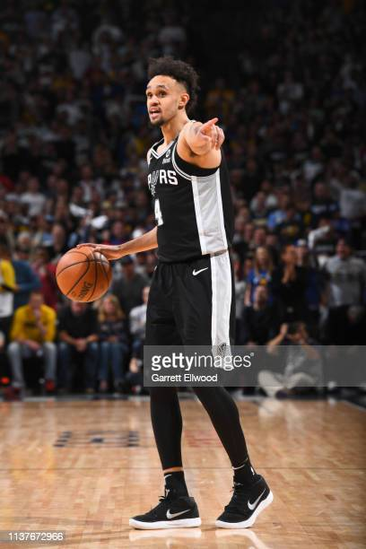Derrick White of the San Antonio Spurs sets up the offense against the Denver Nuggets during Game Two of Round One of the 2019 NBA Playoffs on on...