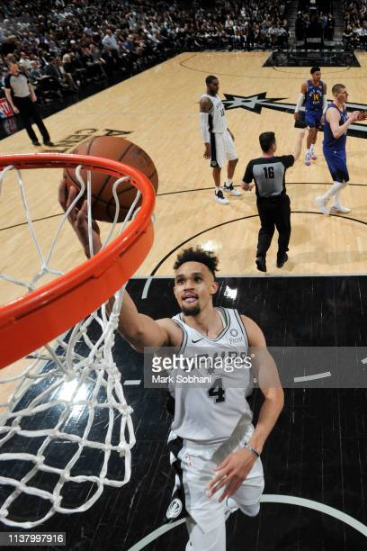 Derrick White of the San Antonio Spurs shoots the ball against the Denver Nuggets during Game Three of Round One of the 2019 NBA Playoffs on April 18...