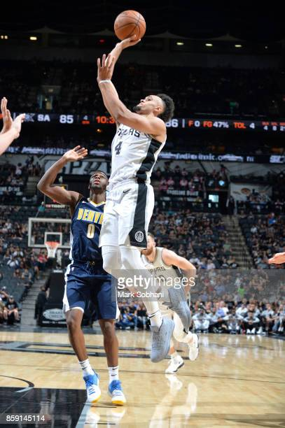 Derrick White of the San Antonio Spurs shoots the ball against the Denver Nuggets during the preseason game on October 8 2017 at the ATT Center in...