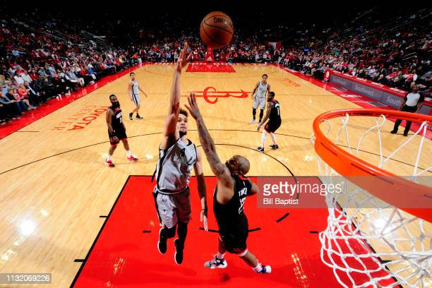 Derrick White of the San Antonio Spurs shoots the ball during the game against the Houston Rockets on March 22 2019 at the Toyota Center in Houston...