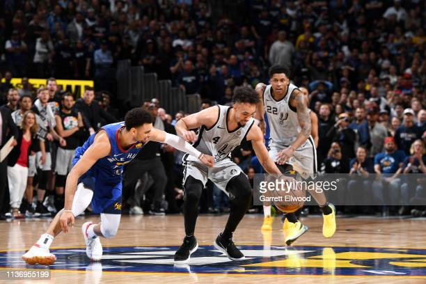 Derrick White of the San Antonio Spurs steals the ball against the Denver Nuggets during Game One of Round One of the 2019 NBA Playoffs on April 13...