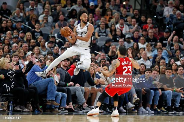 Derrick White of the San Antonio Spurs tries to make a save in front of Fred VanVleet of the Toronto Raptors during second half action at ATT Center...