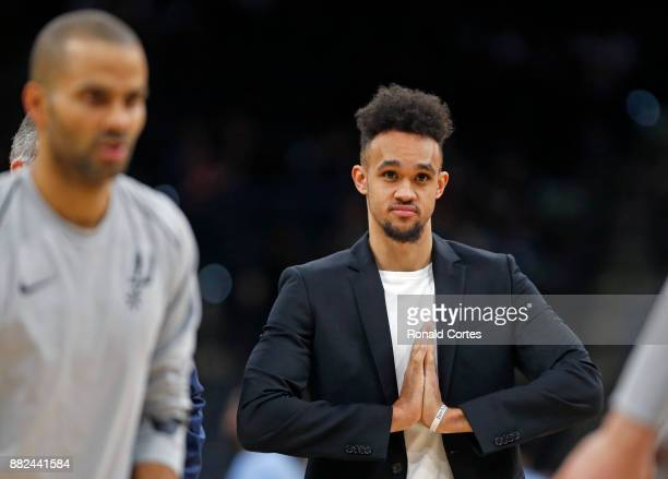 Derrick White of the San Antonio Spurs watches warmups during halftime game against the Memphis Grizzlies at ATT Center on November 29 2017 in San...