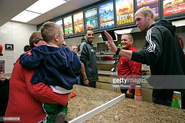 Derrick Williams and Greg Stiemsma of the Minnesota Timberwolves serve customers to raise money to benefit both the Arby's Foundation in support of...