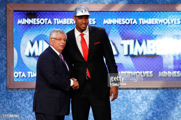 Derrick Williams from Arizona greets NBA Commissioner David Stern after he was selected overall by the Minnesota Timberwolves in the first round...